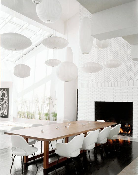 dining area with a collection of nelson bubble lamps.