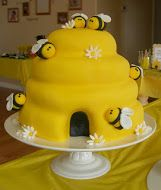 The beehive was 4 layers of vanilla cake iced in vanilla buttercream, covered with yellow fondant, and decorated with fondant bumble bees and flowers.