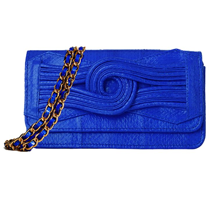 The exotic SUKI snakeskin in electric blue with gold hardware.