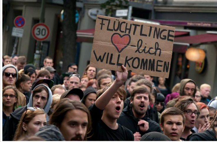 """Pro-refugee demonstration in Berlin, August 31, 2014. Placard reads: """"Refugees welcome."""""""