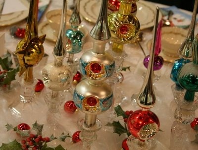 vintage tree toppers displayed in candle holders.....These have angle hair around them