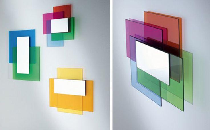 Sono di Glas Italia gli specchi montati su lastre di vetro colorato. La collezione Colour on Colour prevede tre combinazioni di colore: verde+blu, giallo in varie sfumature e blu+verde+fucsia+rosso. La severa geometria delle forme è mitigata dai vetri colorati che, creano un effetto grafico capace di valorizzare un'intera parete. Misurano L 75 x P 4 x H 65 cm, L 70 x P 4 x H 60 cm, L 55 x P 8 x H 55 cm. Prezzo a partire da 753 euro.  www.glasitalia.com