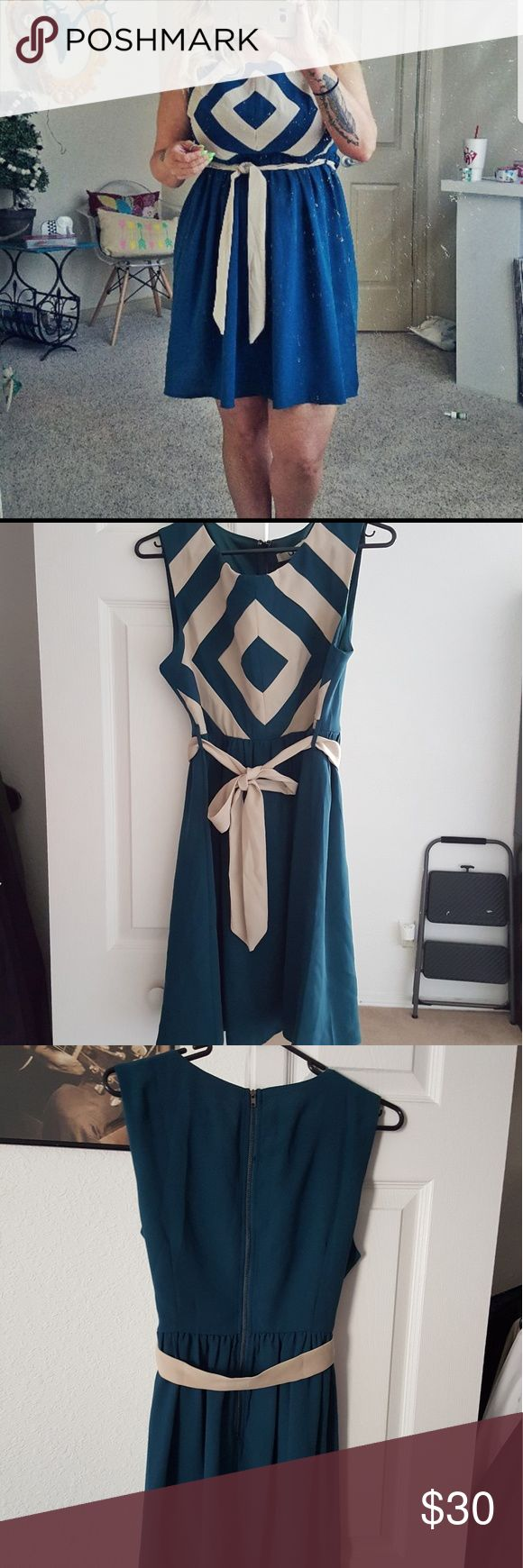 BNWT boutique dress Gorgeous women's dark teal and cream dress with the around waist and zip up back. pet and smoke free home.  size large Ya Los Angeles Dresses Midi