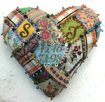 Contemporary patchwork heart inspired by WW1 sweetheart pincushions.