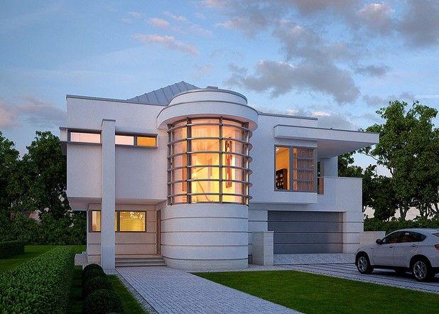 Piętrowy budynek z płaskim dachem, wyróżniający się niebanalną, nowoczesną architekturą. Jednym z interesujących elementów jest umieszczona od strony frontowej przeszklona, półokrągła klatka schodowa. W części ogrodowej niezmiernie atrakcyjnie prezentują się natomiast rozległe, zadaszone tarasy.