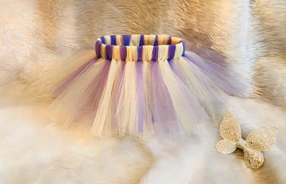 Every little girls deserves there own tutu whether is for their birthday, or just for imaginary play. This beautiful tutu is made out off lavender and ivory tulle material the perfect fabric for tutus. With an elasticated waist this tutu is made to fit and comfortable on those