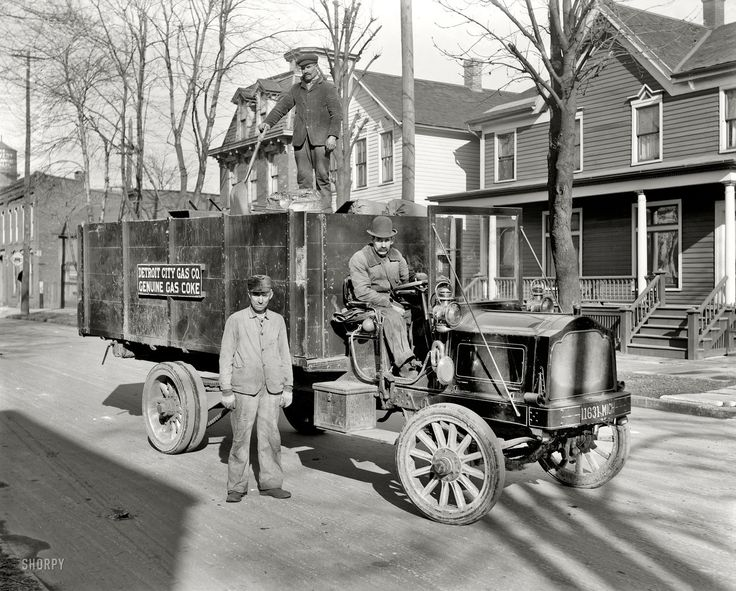 Detroit City Gas Company gas coke delivery wagon and workers. Circa 1912. There are some interesting details on the Packard truck theyre driving. Particularly the wood framed glass windshield and the squeezable bulb horn.