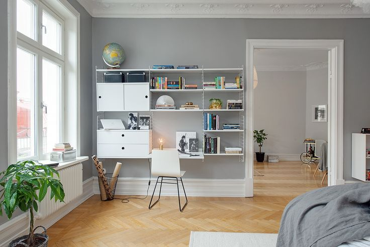Scandinavian design usually centers upon a stark, black-and-white aesthetic — which is why we're so excited to see gray walls making a comeback. They provide the same neutral, monochromatic appeal, but dial it back a few notches. (As seen at Bungalow 5.) - ELLEDecor.com