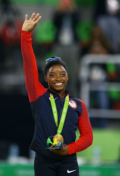 #RIO2016 Gold medalist Simone Biles of the United States celebrates on the…