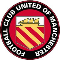"""A circular badge with """"Football Club United of Manchester"""" written in white capitals just inside the black circumference with a red trim. Inside is a yellow crest on a red background. The crest has a yellow ship with three sails on a white background, and three yellow stripes on a red background."""