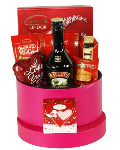 This Valentine offer your love one a Romance Sweet Basket Box filled with decadent chocolate and a bottle of Baileys ... this will for sure set the mood for a romantic evening!