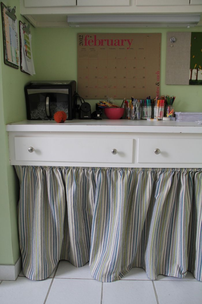 Craft Room - House on Hill Road has her craft area in her laundry room.  Love that calendar!