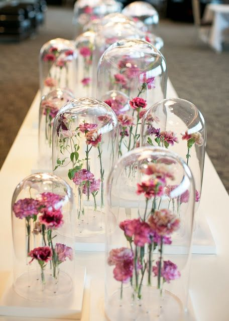Glass domes & flowers centrepieces