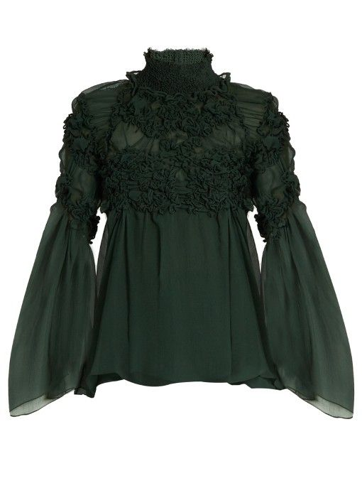 Chloé's forest-green silk-crepon blouse is meticulously detailed with a smocked floral-effect high neck, yoke, and shoulder panels. It comes with an optional slip lining, leaving the elegant bell sleeves sheer. Wear yours with a fluid wrap skirt and lace-up ankle boots to perfect the label's bohemian aesthetic.
