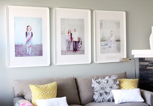 Set of 3 wall portraits -- beautiful in the all white frames (frames from IKEA I think). These are probably 16x20s - this look would also work with 11x14s but with more spacing and slightly less impact.