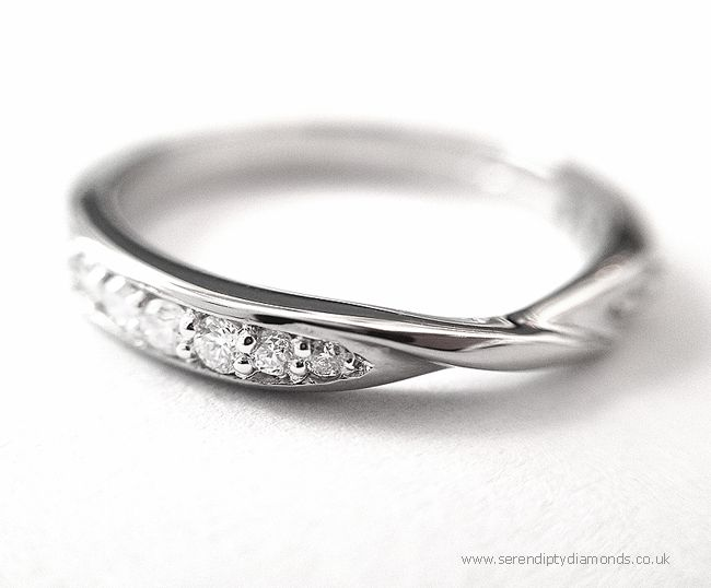A Ribbon Twist wedding ring shown with border and grain set diamonds.