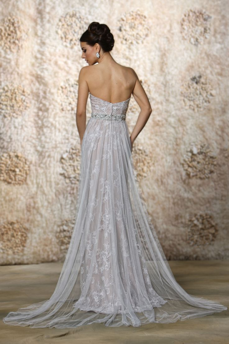 Beautiful This classic strapless A line gown with tulle overlay lace sparkles with detachable beaded capelet and waist belt Fabric Tulle Lace Satin Available Color