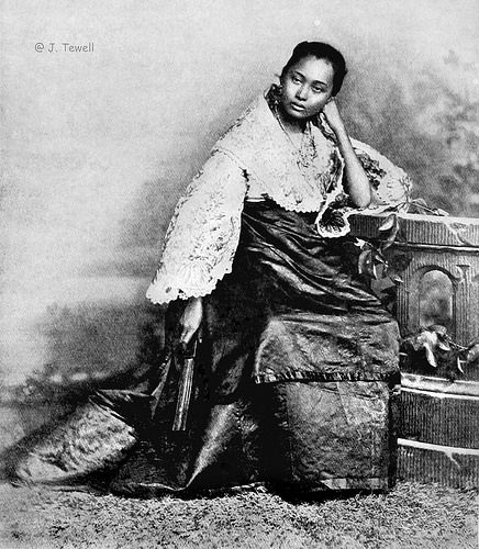 Full blooded native girl in reception attire, Manila, Philippines, 1899 or before