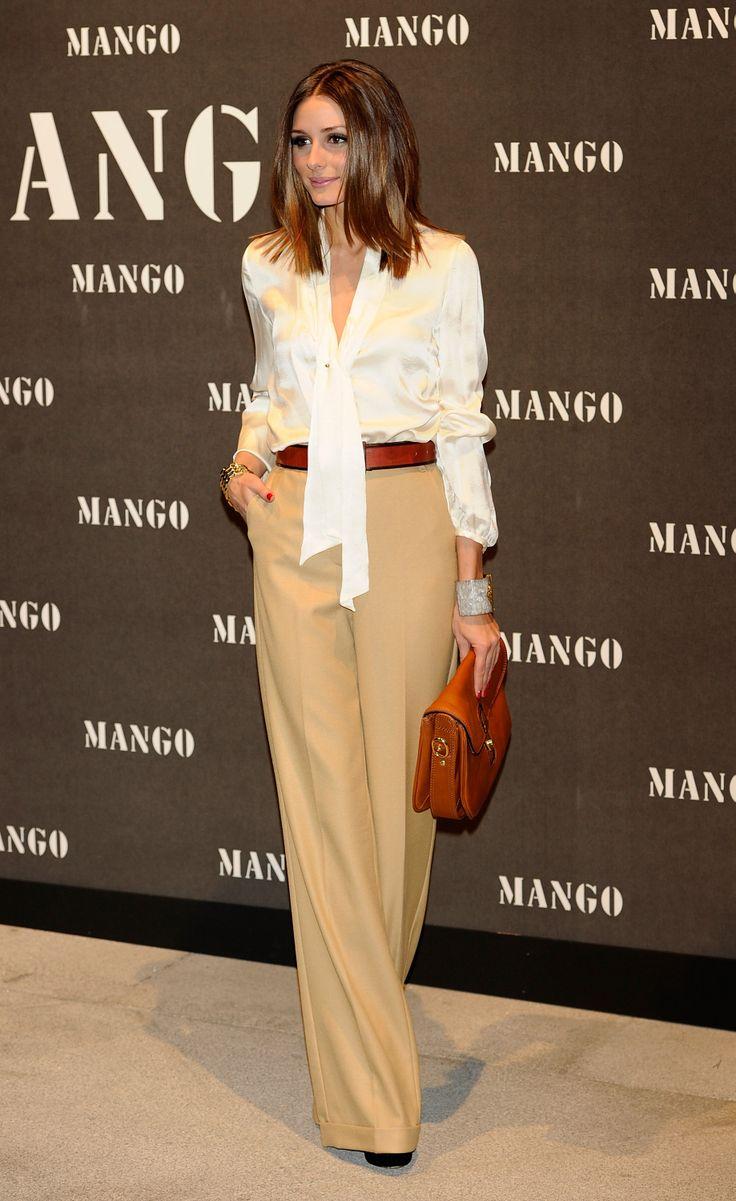 Olivia offers an elegant take on seasonal wear in Mango — just add a silky white blouse to wide-leg trousers.