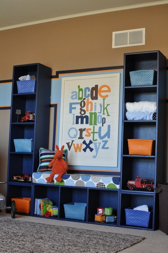 3 bookcases screwed together! Love the little bench it creates! Perfect for a kids room reading nook or play room storage