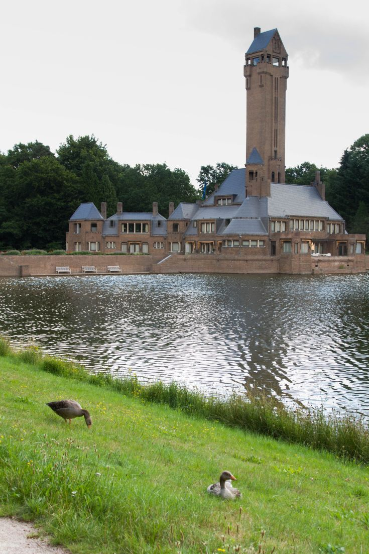 The Jachthuis Sint Hubertus (Hunting Lodge) in Hoge Veluwe National Park - Netherlands.  A day trip from Amsterdam, you will want to take the kids to this amazing park with some fantastic museums, playgrounds, coffee shops, and free bikes to ride.  Click through to find out more!