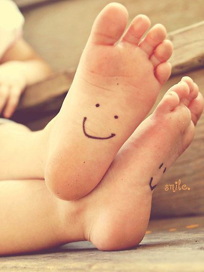Draw a happy face on each child's foot and take a photo for mom/dad's day - Happy Feet fun!