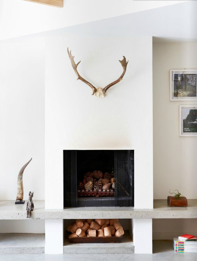 Est Issue 6 - not a super huge fan of the decor, but LOVE the modern clean lines of this fireplace & mantle. also - clever place to keep the firewood.