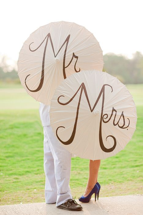 Cute idea for wedding umbrellas so come rain or shine you'll both still look lovely.