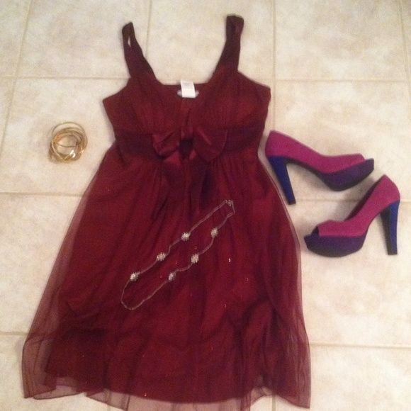 Speechless plus size knee length Dress Beautiful knee length deep maroon colored dress there glitter on the sheer puff part of the dress beautiful bust line and sash great w heels for prom or wedding brand is Speechless will fit plus size its a 13 size dress ! Only worn one time so beautifully made Speechless Dresses Mini