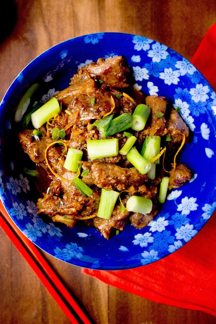 "This recipe for takeout-style orange beef is a variation on one the Brooklyn chef Dale Talde included in his new cookbook, ""Asian-American: Proudly Inauthentic Recipes From the Philippines to Brooklyn,"" with a slightly more intensely flavored orange-flavored sauce. Use very good steak, and cook it fast, so that below the lovely crust of its egg-white-and-cornstarch batter, the meat remains rare and luscious. (Photo: Rikki Snyder for The New York Times)"