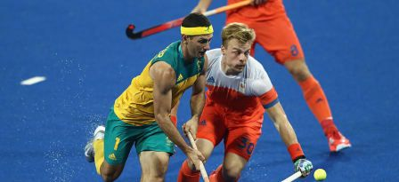 RIO DE JANEIRO, BRAZIL - AUGUST 14: Jamie Dwyer (L) of Australia is challenged by Mink van der Weerden during the Men's hockey quarter final match between the Netherlands and Australia on Day 9 of the Rio 2016 Olympic Games at the Olympic Hockey Centre on August 14, 2016 in Rio de Janeiro, Brazil. © 2016 Getty Images