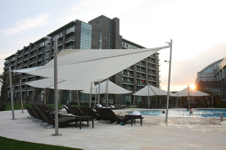 Intrepid - beautiful retractable sail awnings, designed and manufactured in Italy, derived from genuine nautical technology. For private and commercial spaces. This is the Haevichi Hotel, Korea.