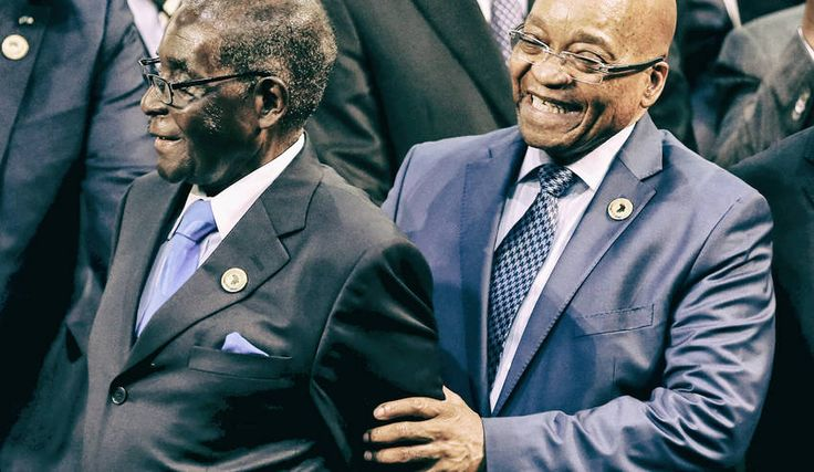 Photo: Zimbabwe President Robert Mugabe (L) reacts next to South Africa's President Jacob Zuma during the opening of the 25th African Union summit in Johannesburg, June 14, 2015. REUTERS/Siphiwe Sibeko