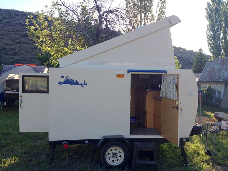 This Handcrafted Tiny Camping Trailer Has A Hatched Roof