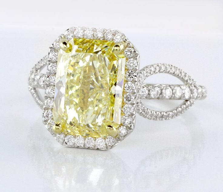 Engagement ring.  Featuring a natural Fancy Canary Yellow radiant diamond weighing nearly 3 carats, mounted in 18k gold with sparkling diamond pave.    http://www.adiamor.com/Design-Your-Own/Ring