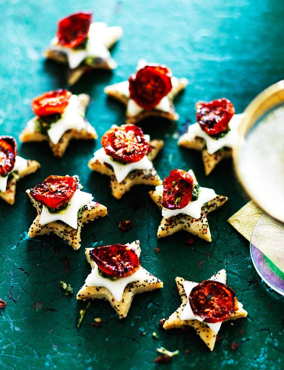 Parmesan shortbreads with mozzarella, cherry tomatoes and pesto, from Sainsbury's magazine.   Cute little star pastries topped with cherry tomatoes and thyme.
