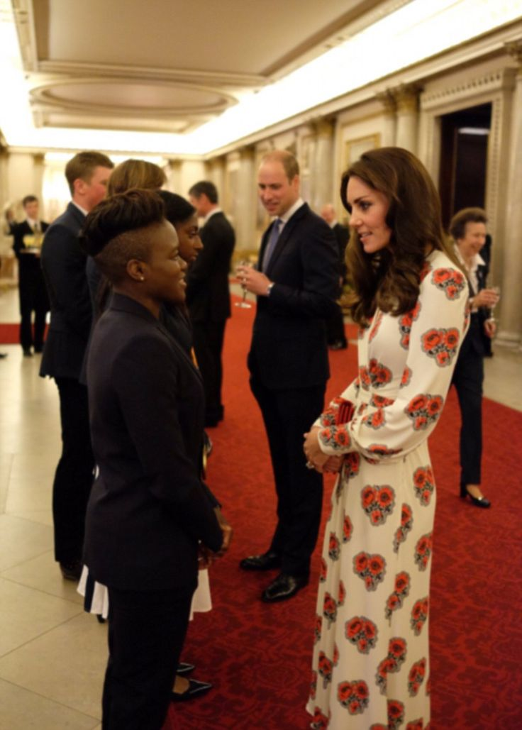 Kate's long-sleeved dress, which was cinched in at the waist, showcased her enviable frame as she spoke to the athletes, including boxer Nicola Adams, who claimed a gold medal at Rio
