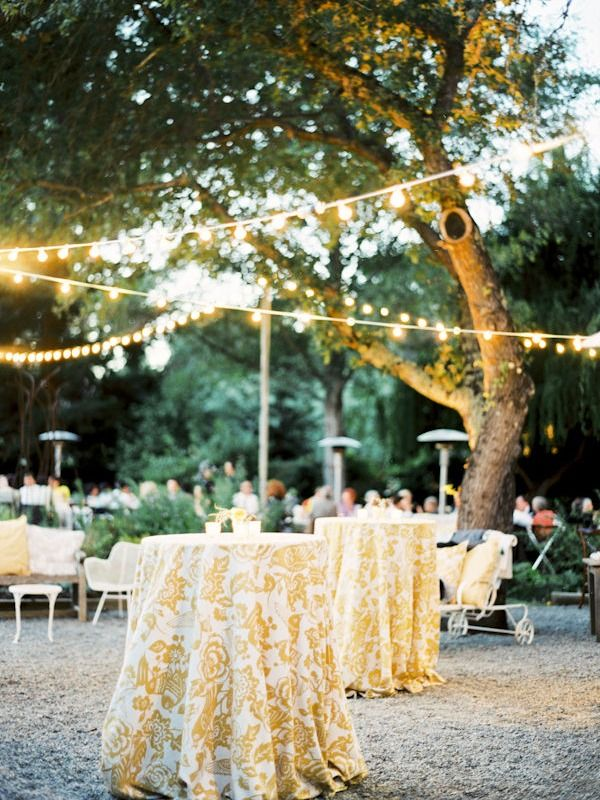 A Garden Wedding by Gia Canali + A Shared Dress | Style Me Pretty | love those cocktail table linens!