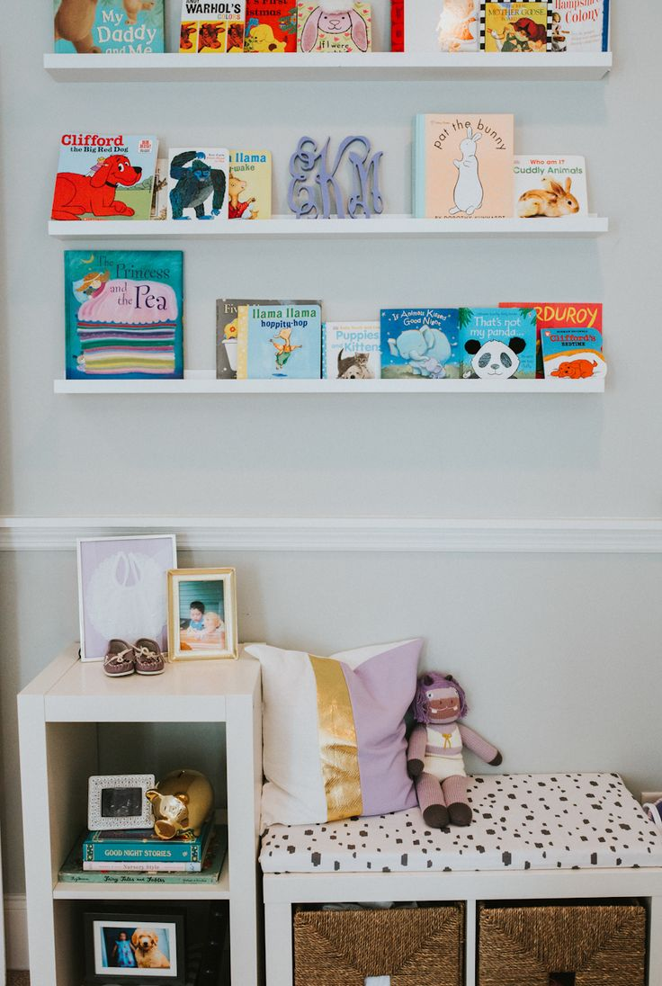 Look at this cute little nursery book nook!