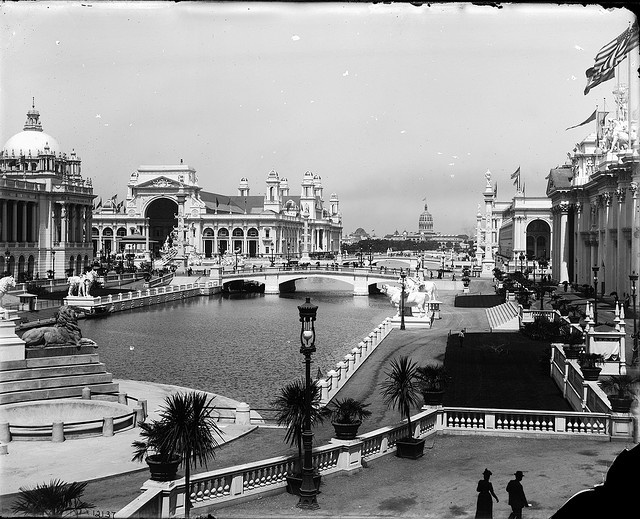 Chicago World's Columbian Exposition, 1893    Description: At the Chicago World's Columbian Exposition in 1893. A view of the reflecting pool traversed by several bridges and several Exposition buildings. The large dome of one of the buildings is visible in the background.