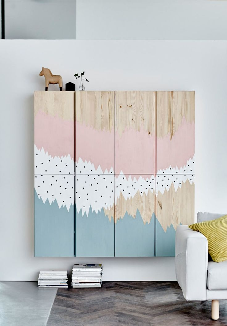 A painted wall mural hides a set of Ikea IVAR cabinets in plain sight. If you don't trust your prowess with a paintbrush, Domino recommends covering the cabinets with graphic wallpaper (http://www.apartmenttherapy.com/51-chic-animal-motif-wallpapers-231075). | Brilliant #IKEAHacks for Big Blank Walls