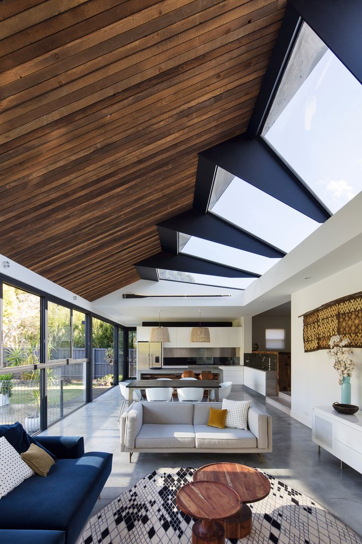 Skylights arranged in rotating formation twist up to a peak on one side of this extension designed by Nick Bell Design for the rear of a Sydney residence.