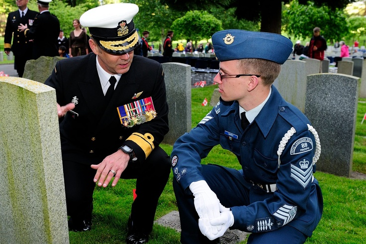 Candlelight Tribute recognizes end of First World War armistice.  Rear-Admiral Bill Truelove Commander Maritime Forces Pacific tells a story to Air Forces Cadet Sergeant Ryan Davies at the Candle Light Vigil Tribute.   Image by: Corporal Michael Bastien, MARPAC Imaging Services ©2013 DND-MND Canada