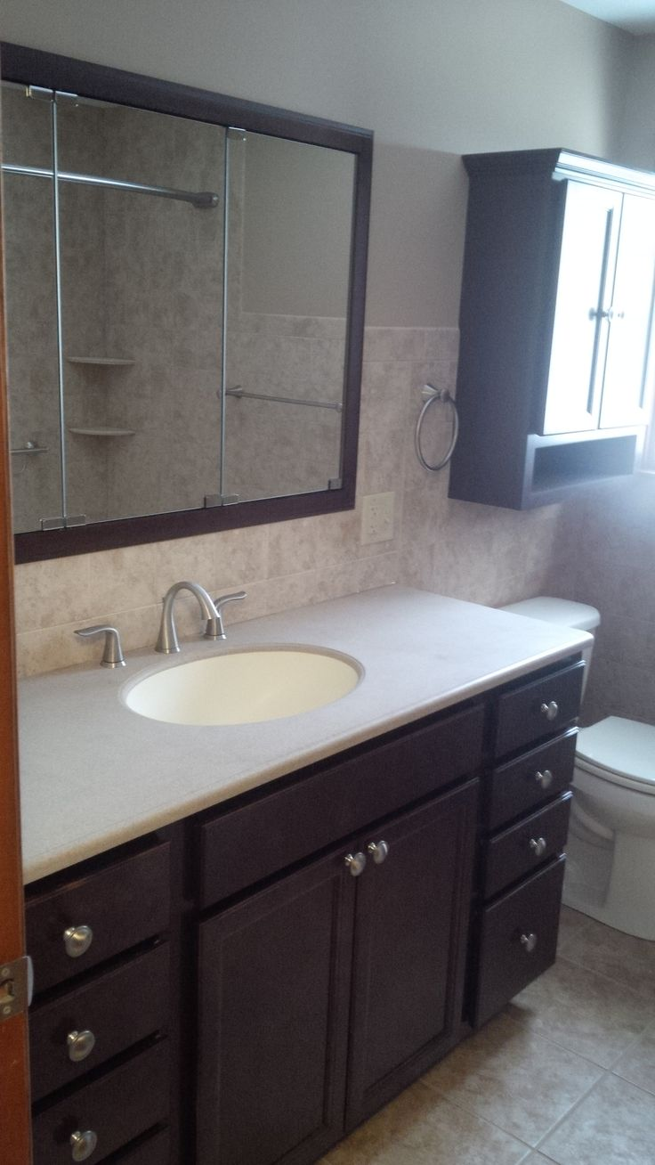 Corian bathroom countertops - Full Bathroom Remodel Featuring Matching Cabinets Corian Counter With Under Mount Sink Bowl And