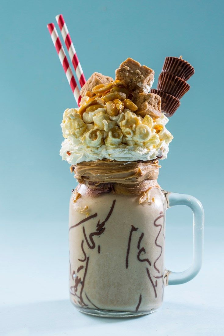 This salted caramel freakshake is the ultimate in indulgence, with whipped cream, caramelised peanuts and fudge pieces piled high upon a salted caramel and peanut butter milkshake.