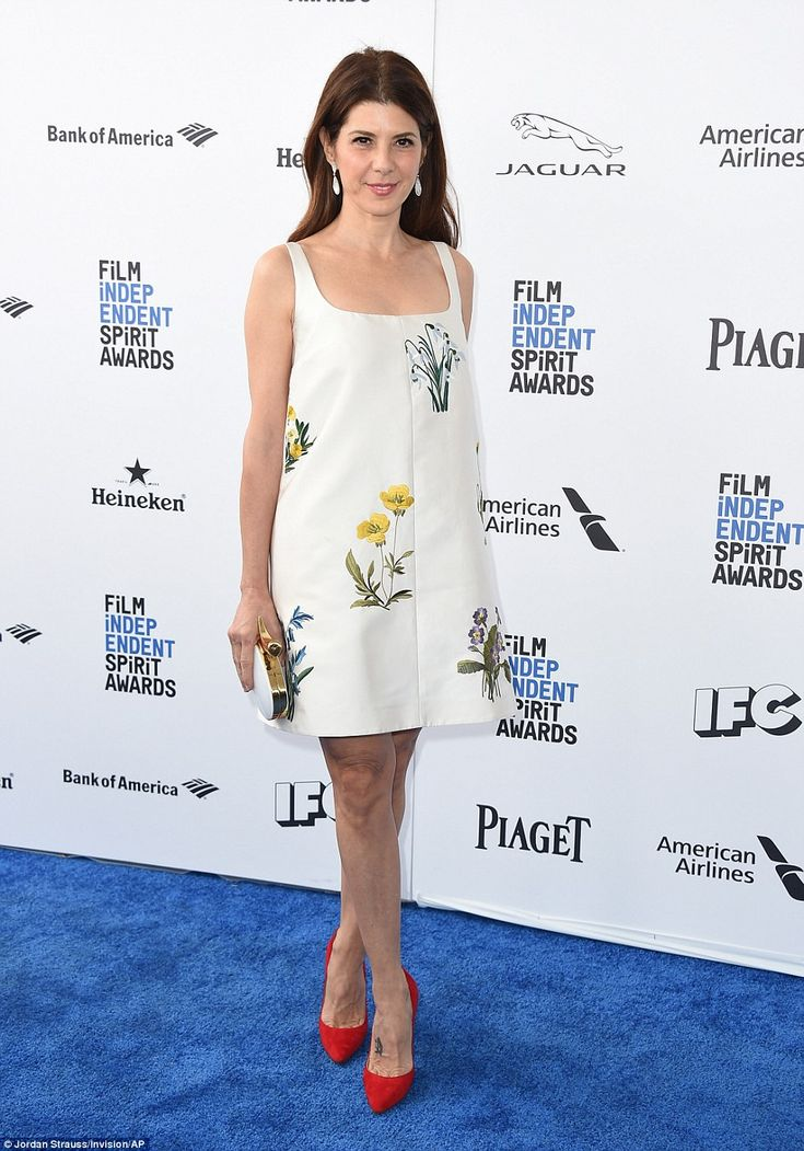Floral fun: Marisa Tomei looked ready for an Easter brunch in her mini dress with sketches...