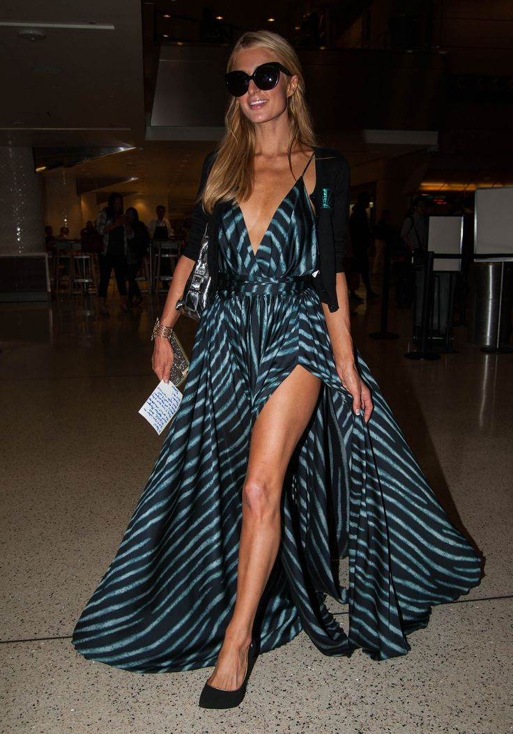 Paris Hilton wows in a stylish dress and high heels at LAX Airport in LA