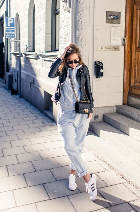 Grey trackies + leather jacket and bag