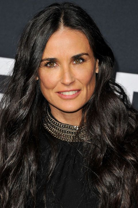 24 celebrity long length hairstyles that will convince you to grow out that bob: Demi Moore's jet black hair compliments her long length hair