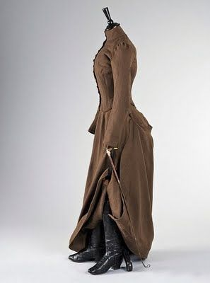 Brown wool riding habit, English, 1880s, together with a pair of black leather 1880s riding boots, and an 1873 leather riding crop with silver collar. Photo Courtesy of Kerry Tayor Auctions.